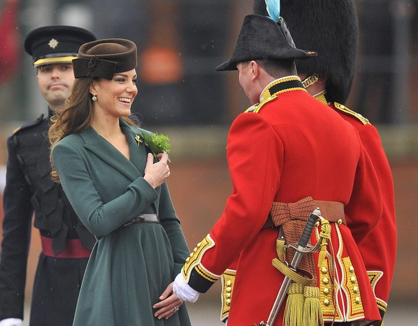 Britain's Catherine, Duchess of Cambridge, presents shamrock flowers at a parade ground at Aldershot army base in southern England March 17, 2012. She was presenting shamrocks to members of the 1st Battalion Irish Guards, a tradition on St Patrick's Day. REUTERS/Toby Melville (BRITAIN - Tags: ENTERTAINMENT MILITARY SOCIETY ROYALS)